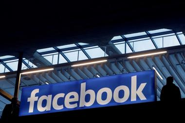 FILE PHOTO: Facebook logo is seen  at a start-up companies gathering at...