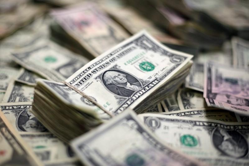 Dollar slips as trade war worries linger; euro climbs