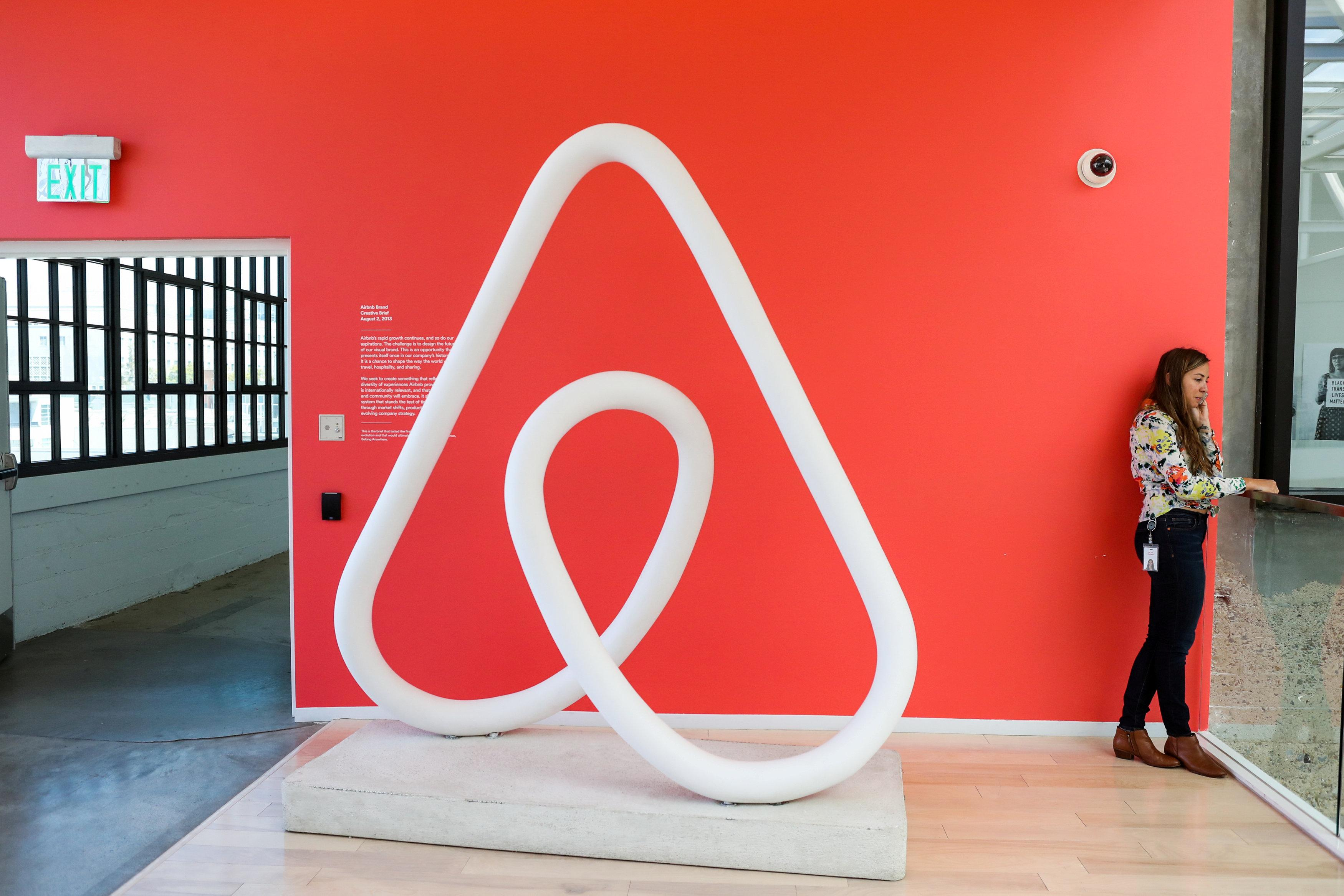A woman talks on the phone at the Airbnb office headquarters in the SOMA district of San Francisco, California, U.S., August 2, 2016.  Gabrielle Lurie