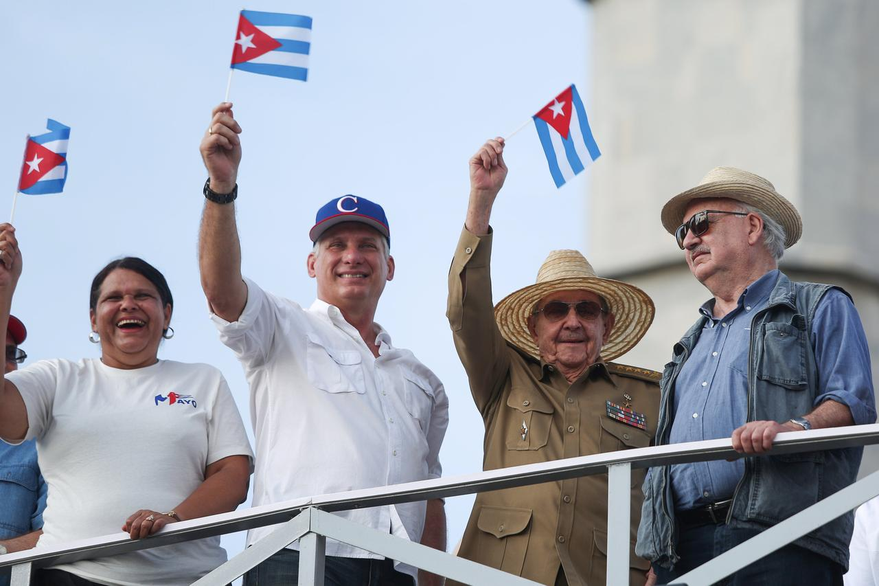 Image result for In show of continuity, Castro flanks new Cuban leader at May Day rally