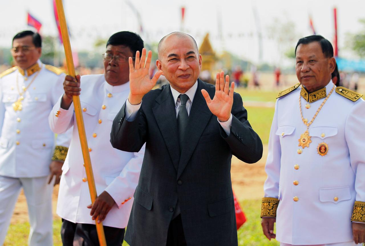 Cambodia's King Norodom Sihamoni greets people as he attends a royal plowing ceremony in Svay Rieng province, Cambodia, May 3   Reuters