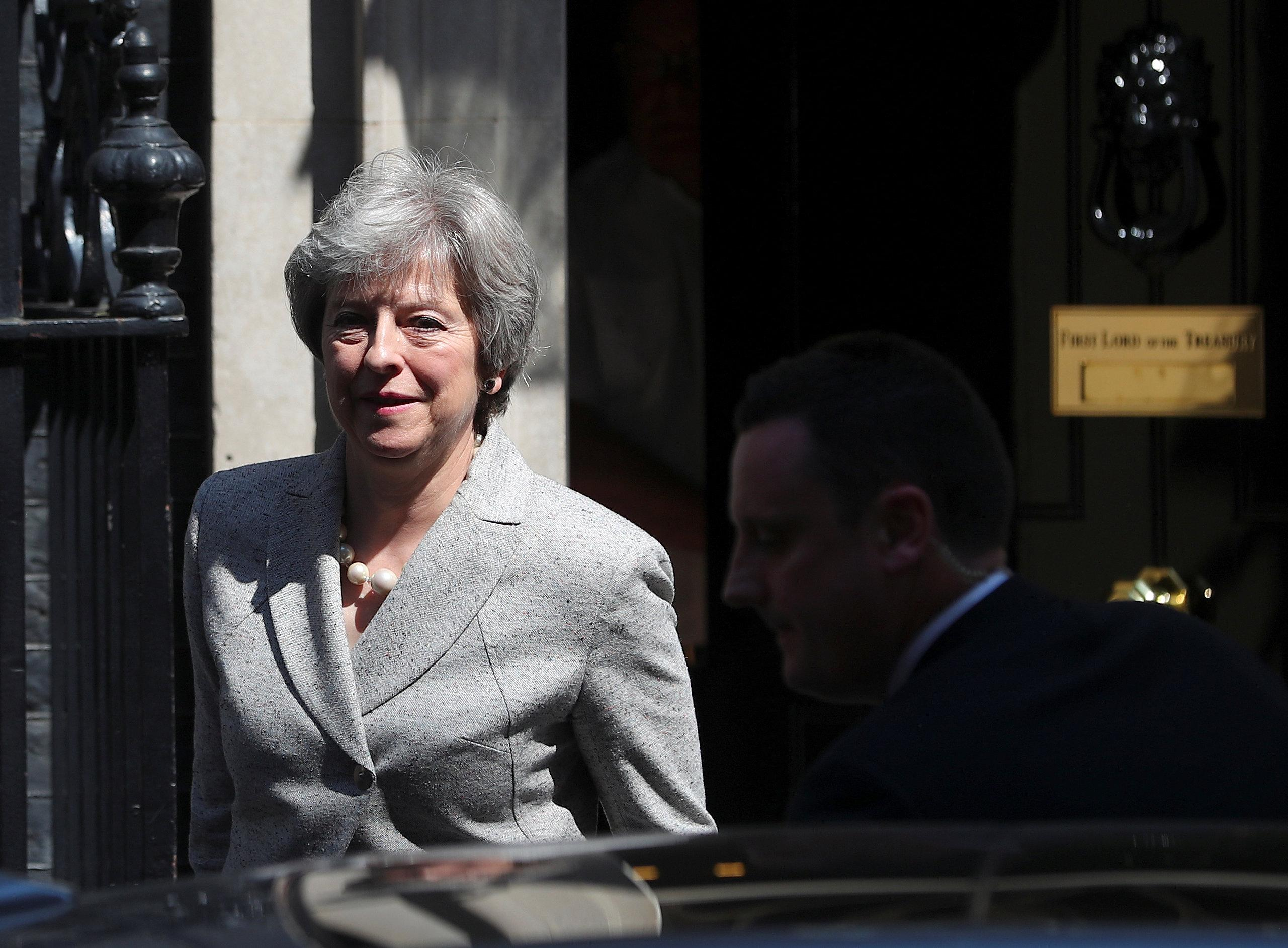 Work on customs plans as a priority, May tells officials