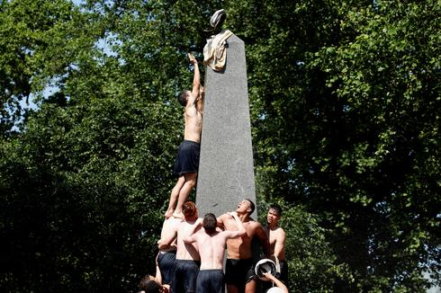 U.S. Naval Academy freshmen climb Herndon Monument