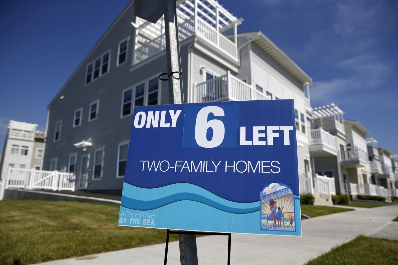 file photo an advertisement for two family homes is seen outside an oceanside community in the rockaway area of the queens borough of new york - Image Of New Home