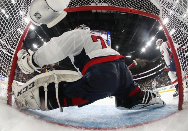 e8f202fdf ... Vegas Golden Knights right wing Reilly Smith (19) scores a goal past  Washington Capitals goaltender Braden Holtby (70) in the second period in game  one ...
