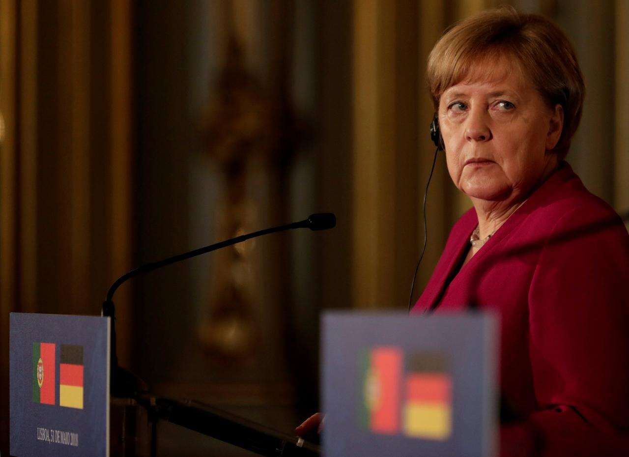 Image result for Solidarity in euro zone should not lead to debt union: Merkel