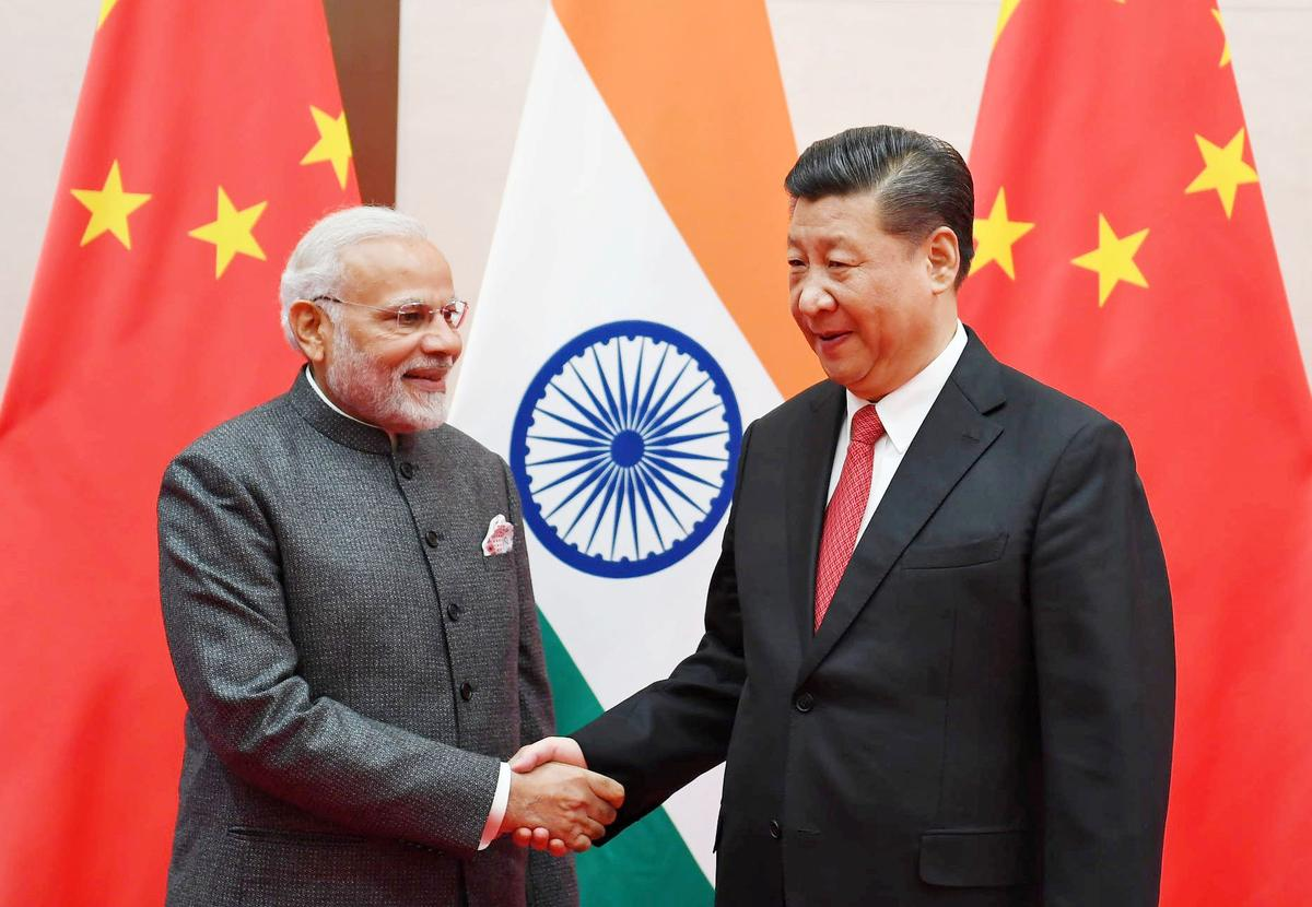 India strikes river, rice deals with China as relations thaw