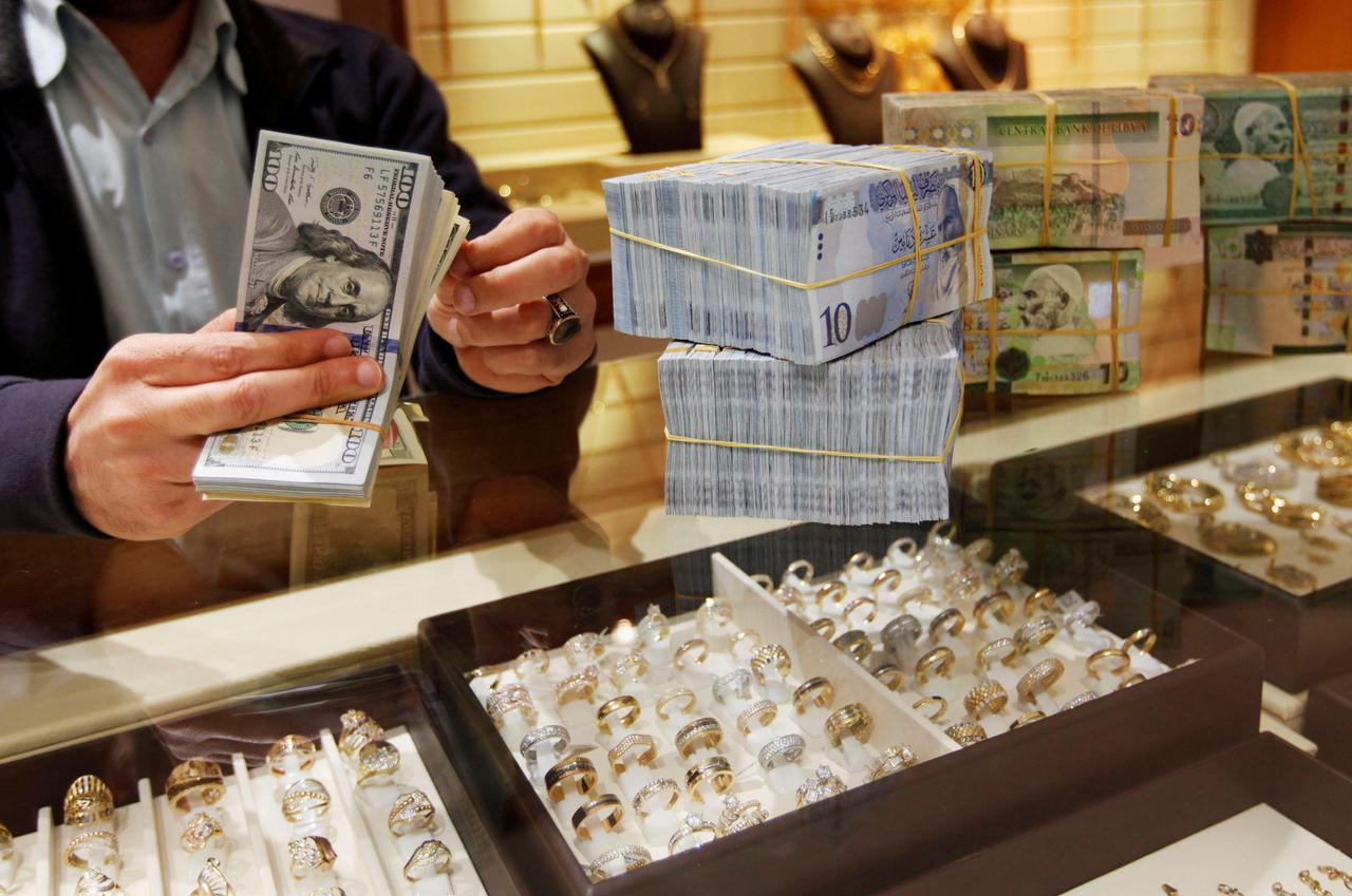 Libyan officials look to foreign currency fees to tackle