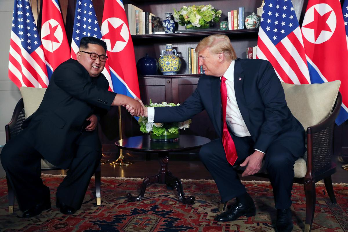 "0b06ca47636 SINGAPORE (Reuters) - U. S. President Donald Trump said he had forged a  ""good relationship"" with North Korean leader Kim Jong Un at the start of a  historic ..."