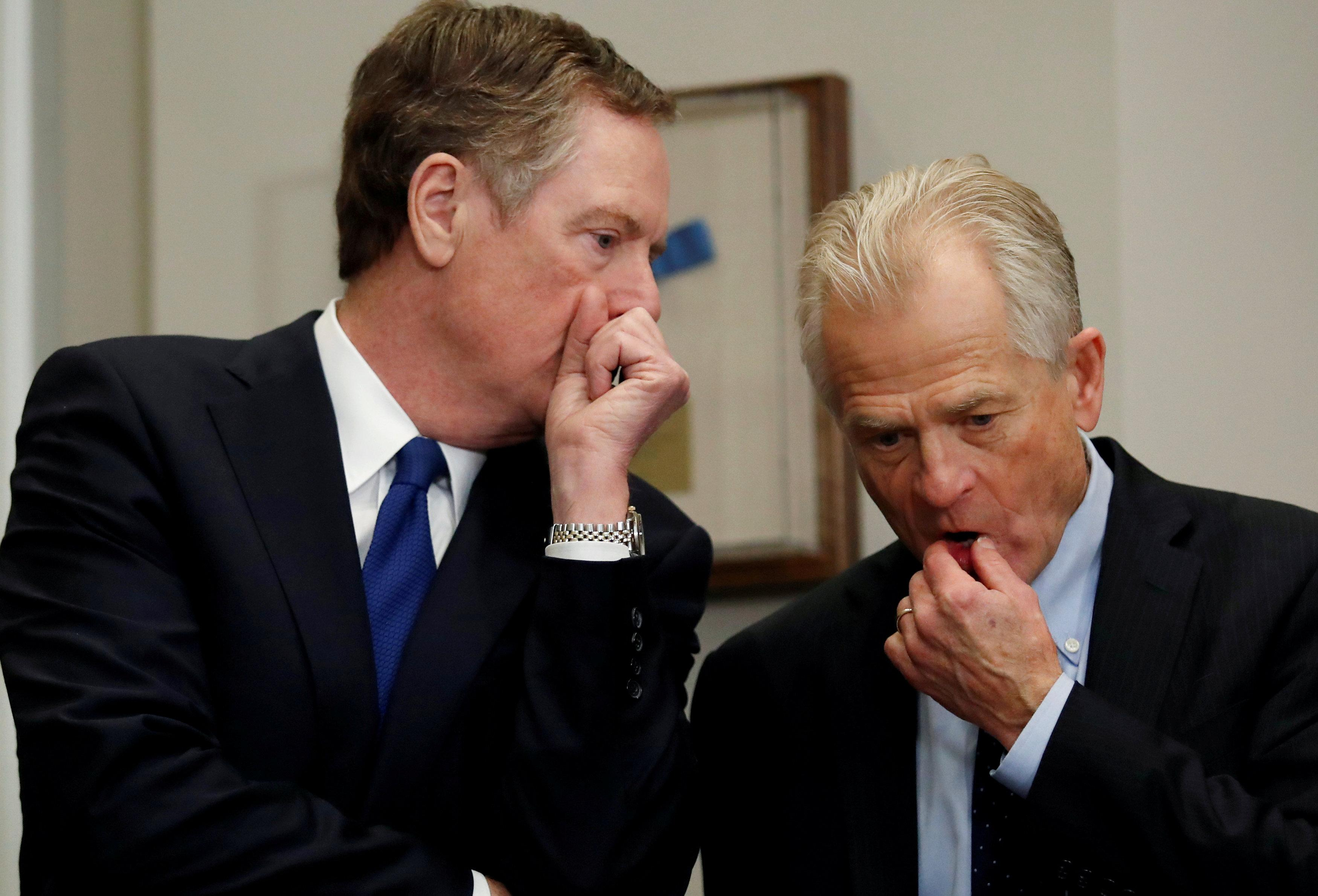 Robert Lighthizer, United States Trade Representative, and Peter Navarro chat while they wait for U.S. President Donald Trump to arrive to make an announcement about new tariffs for steel and aluminum imports at the White House in Washington, U.S. March 8, 2018. Leah Millis