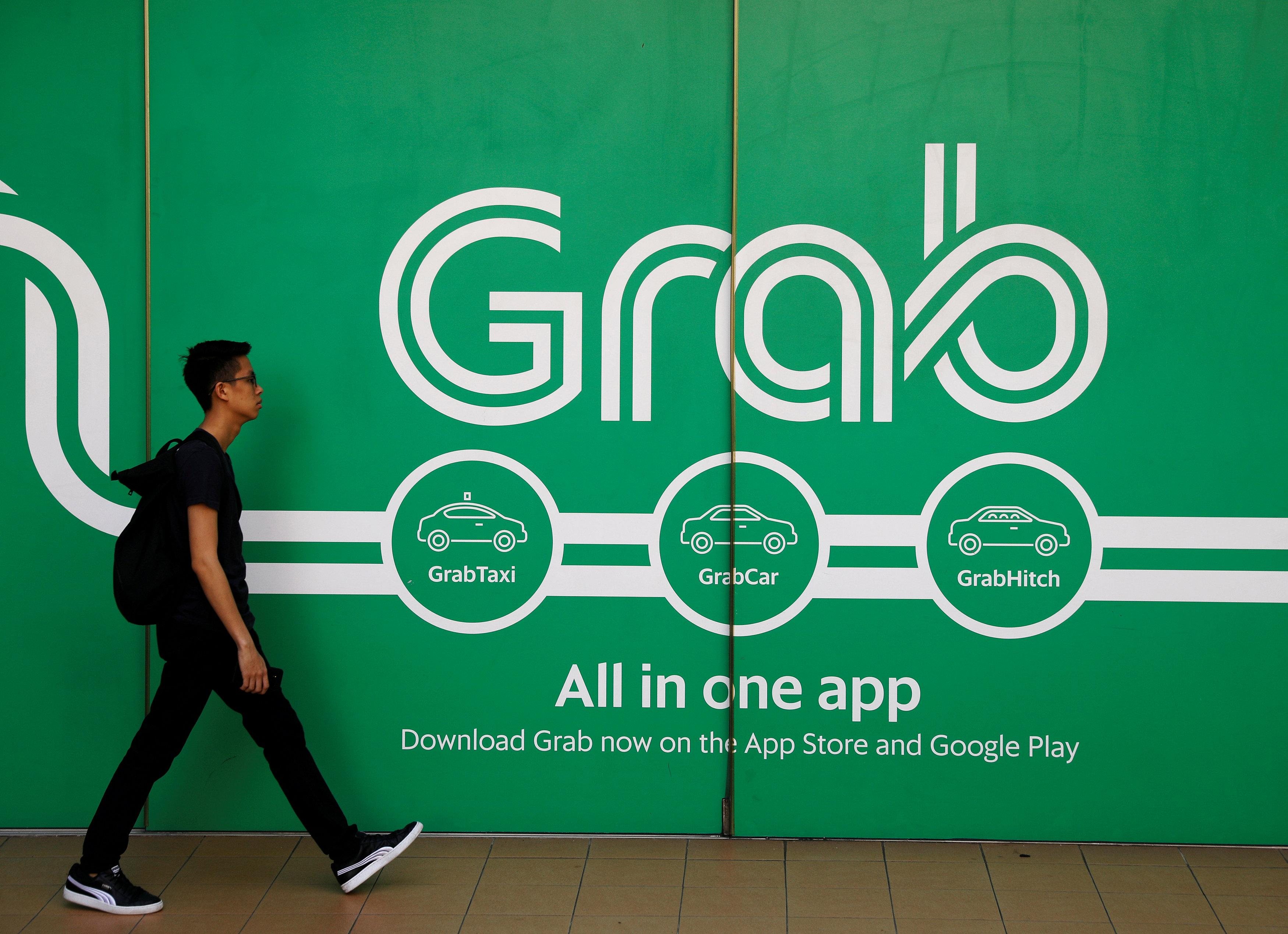 A man walks past a Grab office in Singapore March 26, 2018. Edgar Su