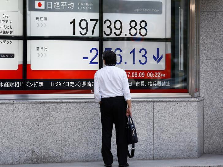 Stocks extend slide, yen up as Sino-U.S. trade dispute escalates   Reuters