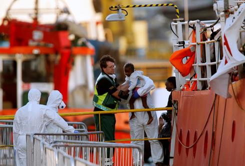 Migrant rescue ship docks, ending standoff