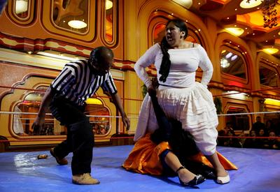Cholitas wrestle in the ring