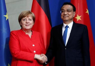 焦点:中德签署一系列合作协议 承诺维护全球多边自由贸易体系