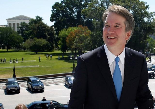 With the U.S. Supreme Court building in the background, Supreme Court nominee judge Brett Kavanaugh arrives prior to meeting with Senate Majority Leader Mitch McConnell on Capitol Hill in Washington, U.S., July 10, 2018. Joshua Roberts
