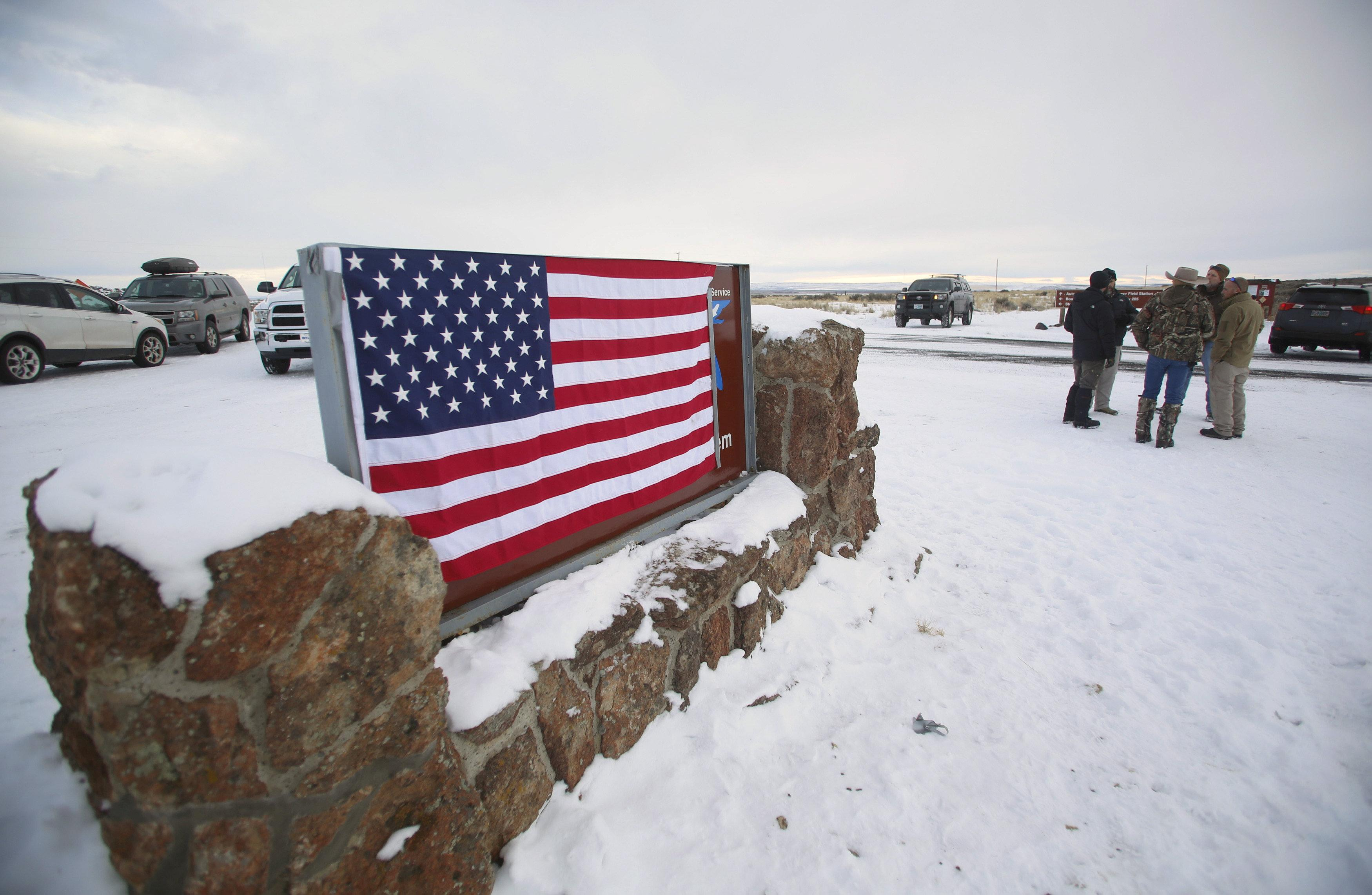 A U.S. flag covers a sign at the entrance of the Malheur National Wildlife Refuge near Burns, Oregon, U.S. January 3, 2016.  Jim Urquhart