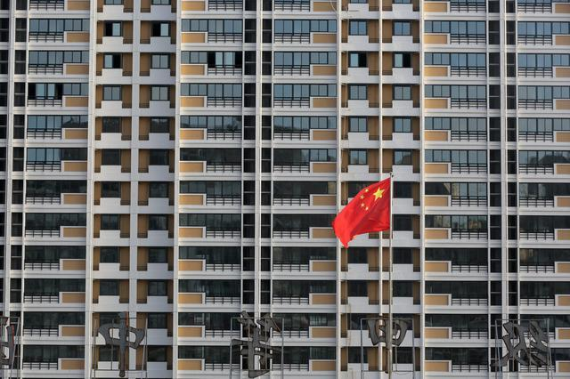 Economists raise China's 2018 GDP growth forecast despite