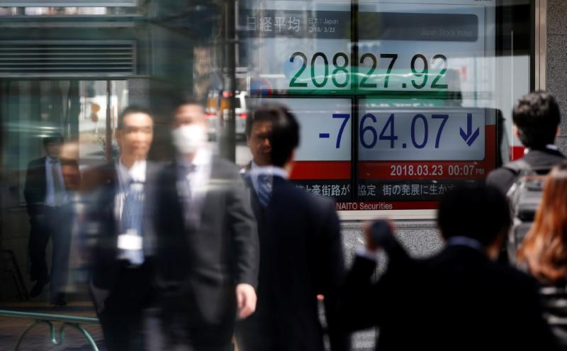 Asian shares extend rebound but trade fears dog China stocks | Reuters