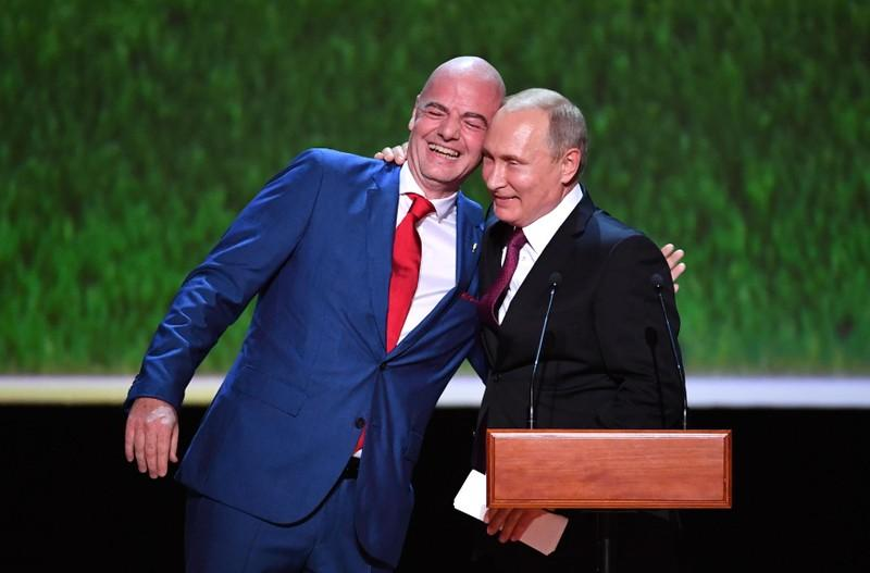 Russias President Vladimir Putin R Embraces Fifa President Gianni Infantino As They Address The Au Nce During A Gala Concert At The Bolshoi Theatre On