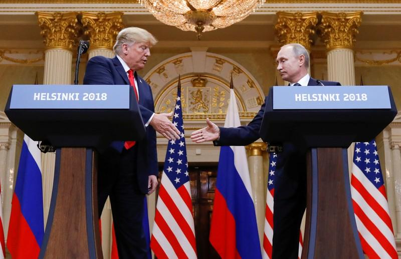 U.S. President Donald Trump and Russia's President Vladimir Putin shake hands during a joint news conference after their meeting in Helsinki, Finland, July 16, 2018. Kevin Lamarque