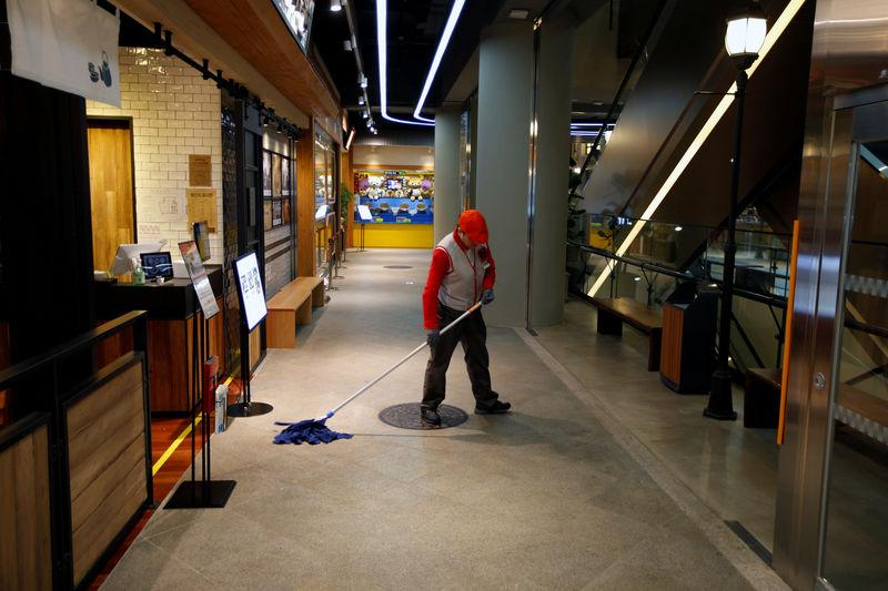 A worker mops the floor at Lotte World Mall in Seoul March 4, 2015.    Kim Hong-Ji