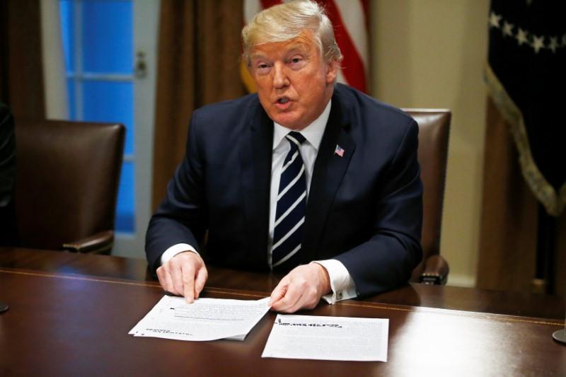 Trump says he has confidence in U.S. agencies on Russia, 'misspoke'...