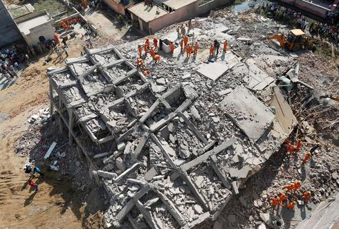 Apartment block collapses in India