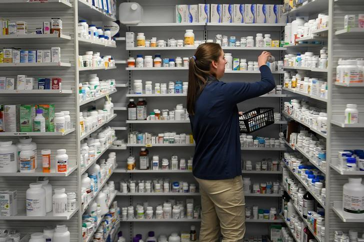 A technician stocks the shelves of the pharmacy at White House Clinic in Berea, Kentucky, U.S., February 7, 2018.   Bryan Woolston