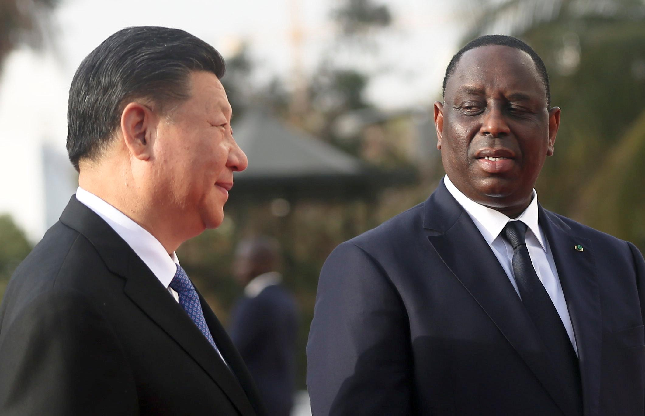 Chinese President Xi Jinping talks with Senegal's President Macky Sall at the Presidential Palace during his visit to Dakar, Senegal July 21, 2018. Mikal McAllister
