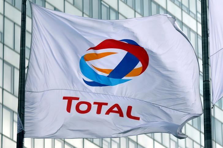 The logo of French oil giant Total is seen on a flag at La Defense business and financial district in Courbevoie near Paris, France. May 16, 2018.  Charles Platiau