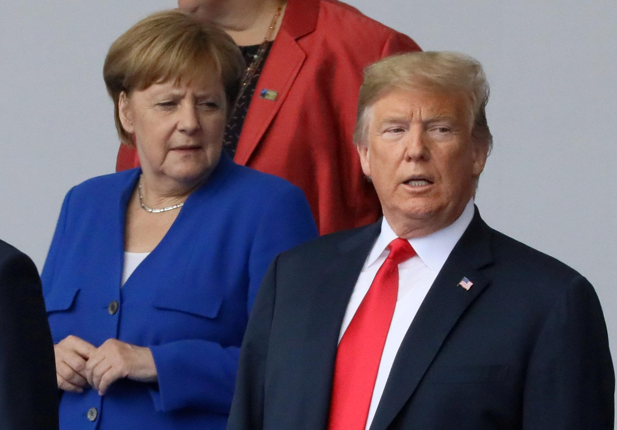 German Chancellor Angela Merkel and U.S. President Donald Trump are seen as they pose for a photo at the start of the NATO summit in Brussels, Belgium July 11, 2018.   Reinhard Krause