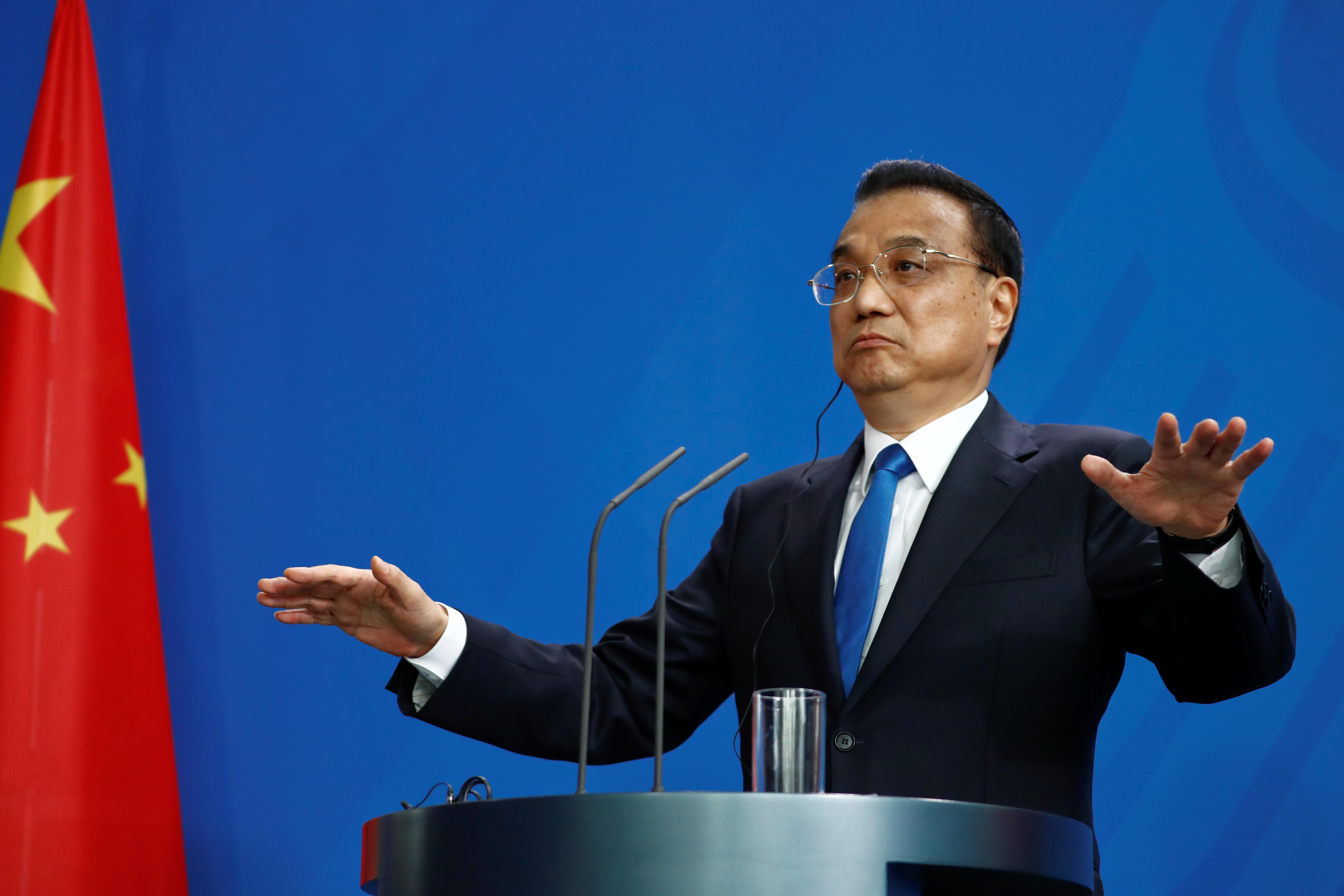 Chinese Prime Minister Li Keqiang reacts as he holds a joint news conference with German Chancellor Angela Merkel (not pictured) at the chancellery in Berlin, Germany, July 9, 2018. Hannibal Hanschke