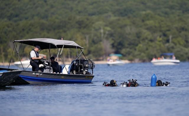July 23, 2018; Branson, MO, USA;  Divers from the Missouri State Highway Patrol enter the water at Table Rock Lake on Monday, July 23, 2018 to begin salvage operations of a duck boat that sank, killing 17 people last week. Mandatory Credit: Nathan Papes/News-Leader via USA TODAY NETWORK