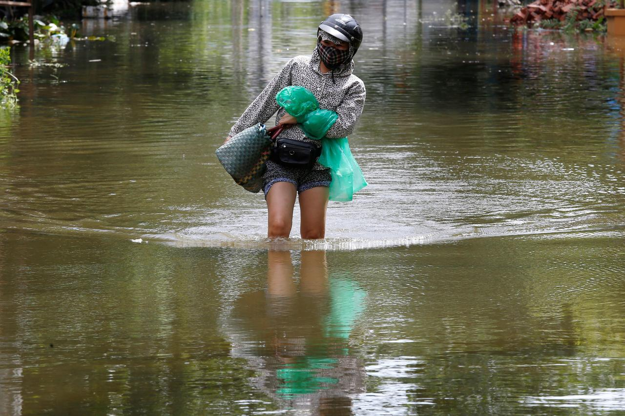 Vietnam flood death toll rises to 27, more rain forecast - Reuters