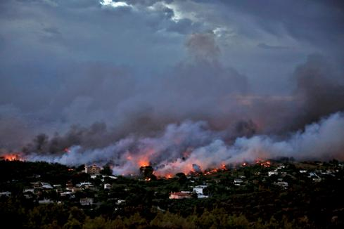 Wildfires rage near Athens