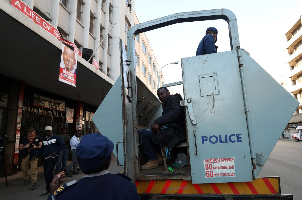 Image result for Police storm Zimbabwe's opposition MDC offices, detain 16 people