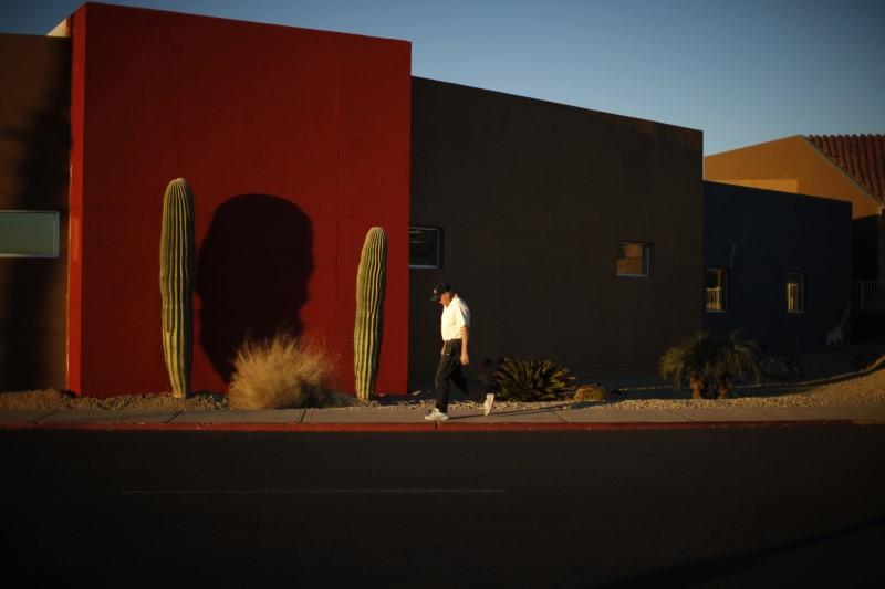 A senior takes a walk in Sun City, Arizona, January 5, 2013. Lucy Nicholson