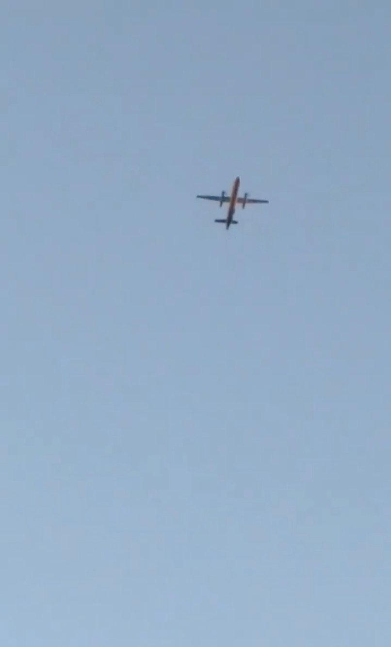 A Horizon Air Bombardier Dash 8 Q400, reported to be hijacked, flies over Fircrest, Washington, the U.S., before crashing in the South Puget Sound, August 10, 2018 in this still image taken from a video obtained from social media. Leah Morse/via