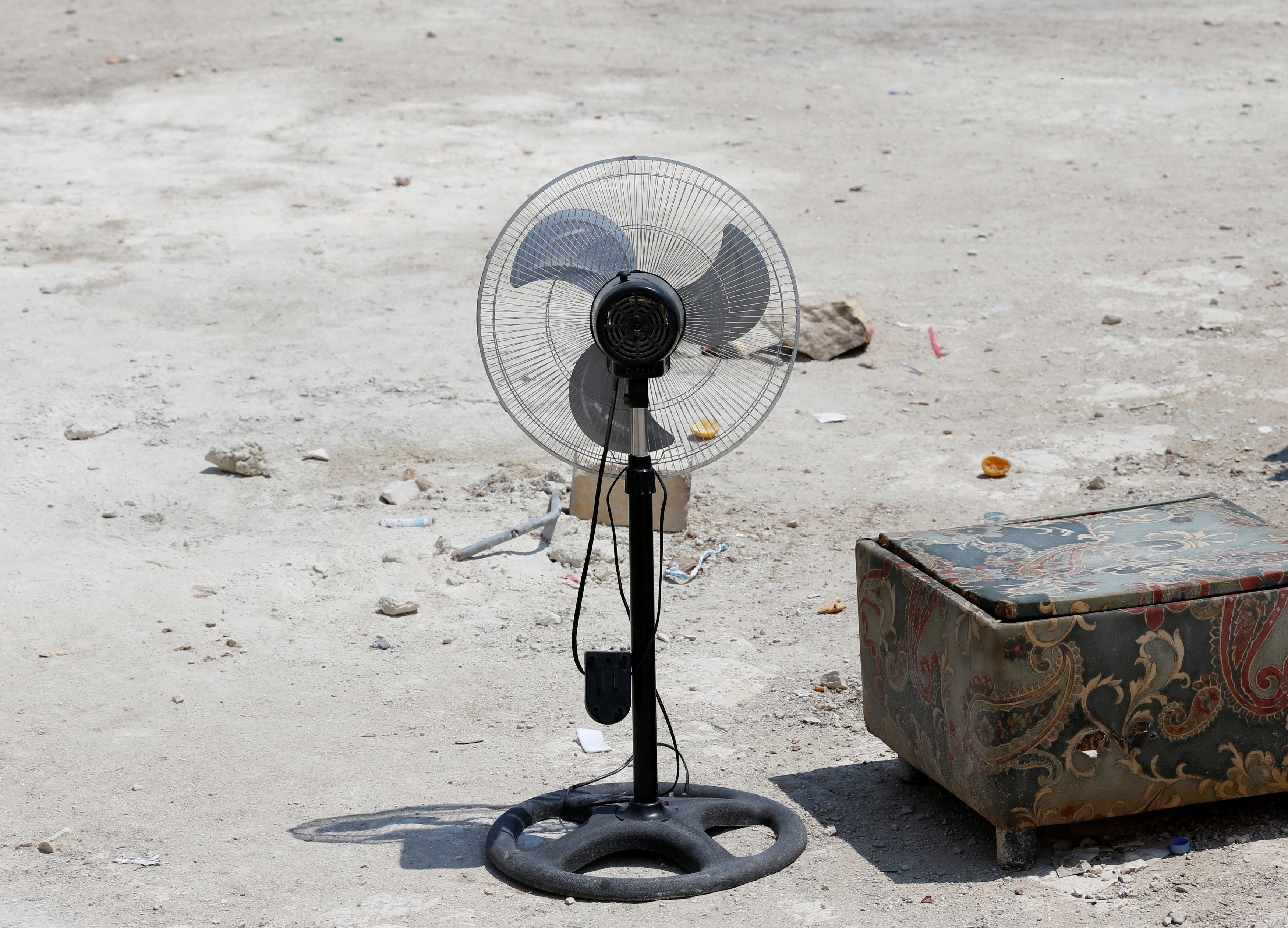 An electric fan is seen on a farm where police evicted some 110 African migrants who had been living in stalls formerly used by cows, in Qormi, Malta August 13, 2018.  Darrin Zammit Lupi