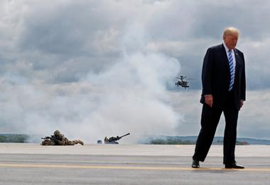 U.S. President Trump observes a demonstration with troops, an attack...