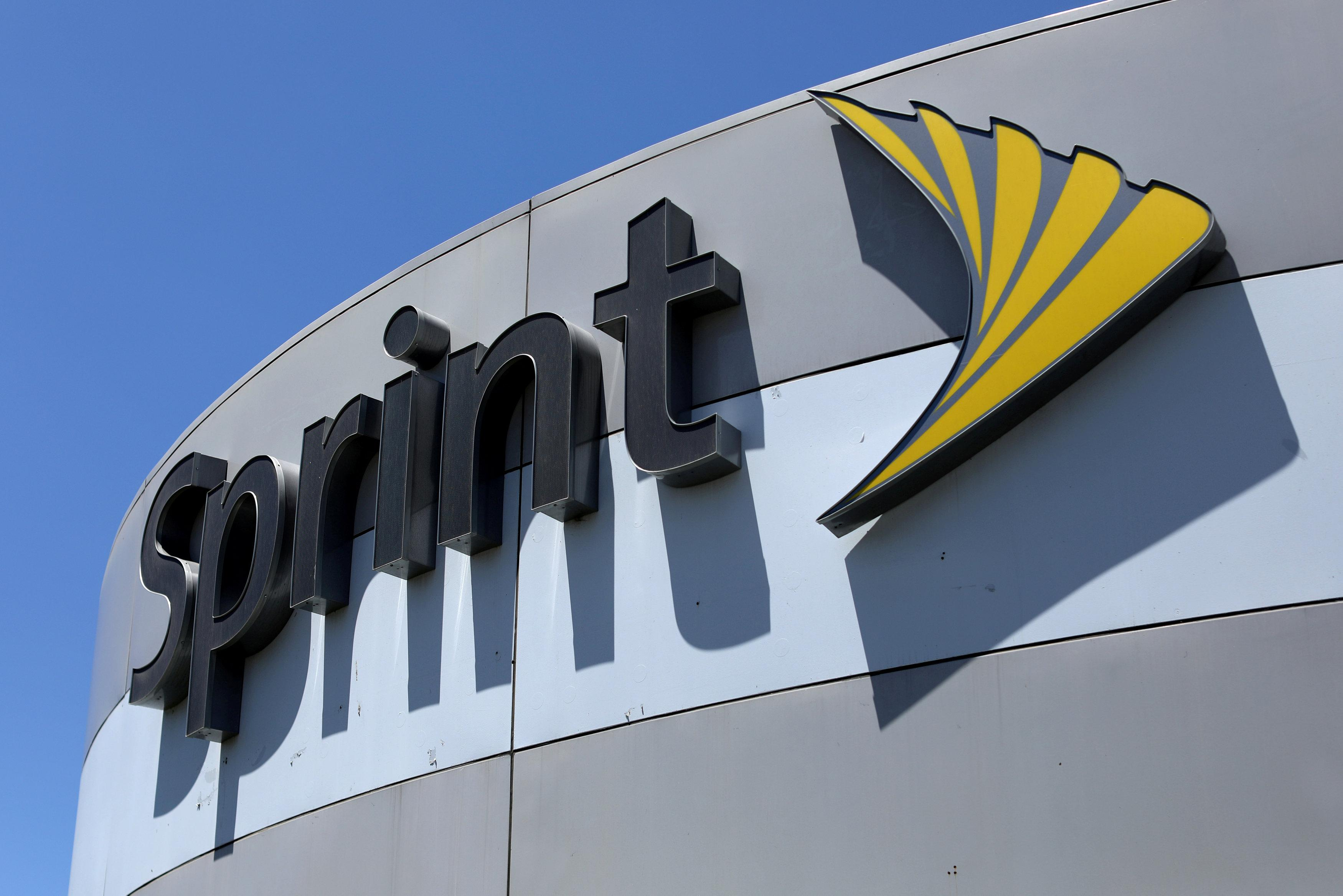 A Sprint store sign is shown in El Cajon, California, Aug. 8, 2017. Mike Blake