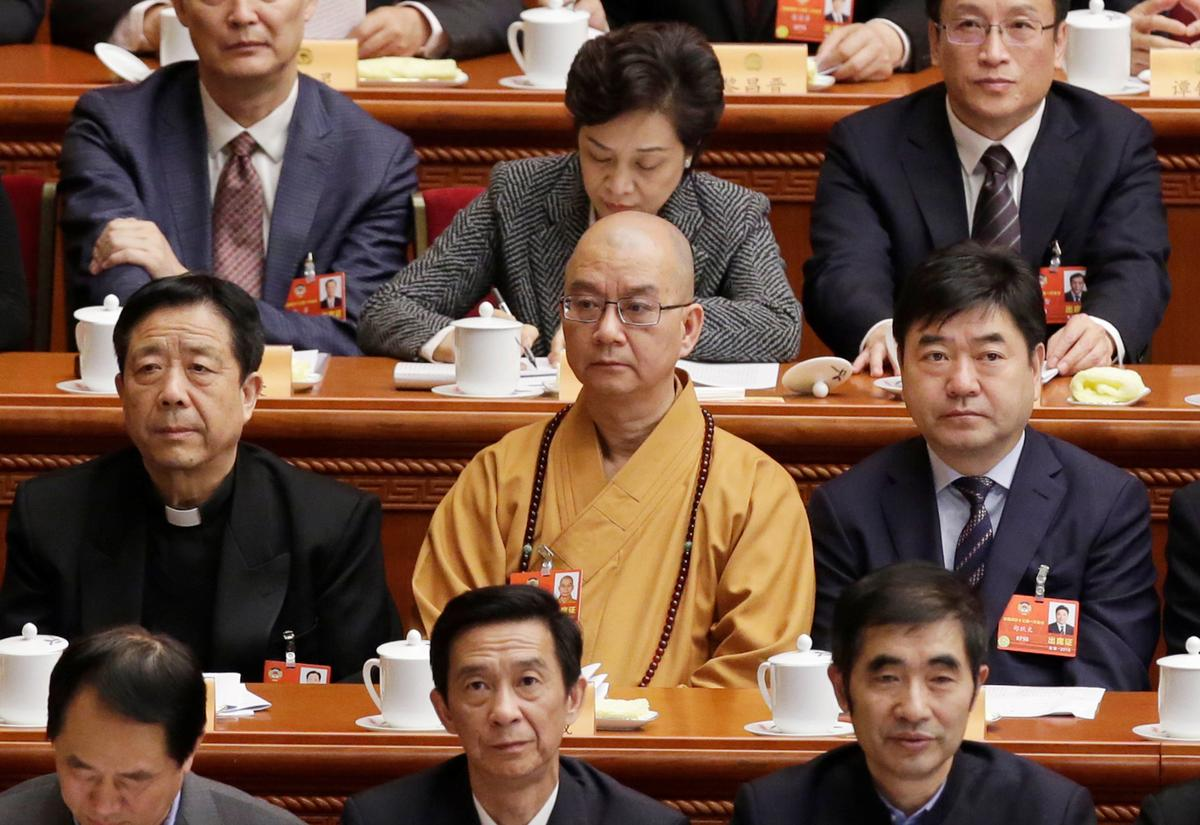 Buddhist monk master in China resigns after sexual misconduct allegations | Reuters