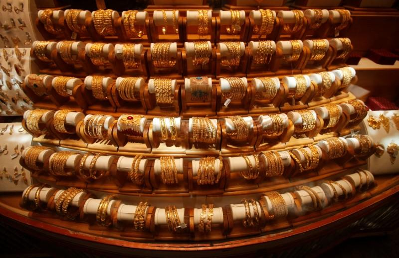 Gold hits more than 18-month low as dollar gains on Turkey