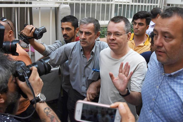 FILE PHOTO: U.S. pastor Andrew Brunson reacts as he arrives at his home...
