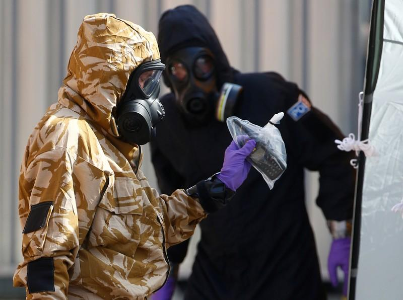 Forensic investigators, wearing protective suits, emerge from the rear of John Baker House, after it was confirmed that two people had been poisoned with the nerve-agent Novichok, in Amesbury, Britain, July 6, 2018. Henry Nicholls