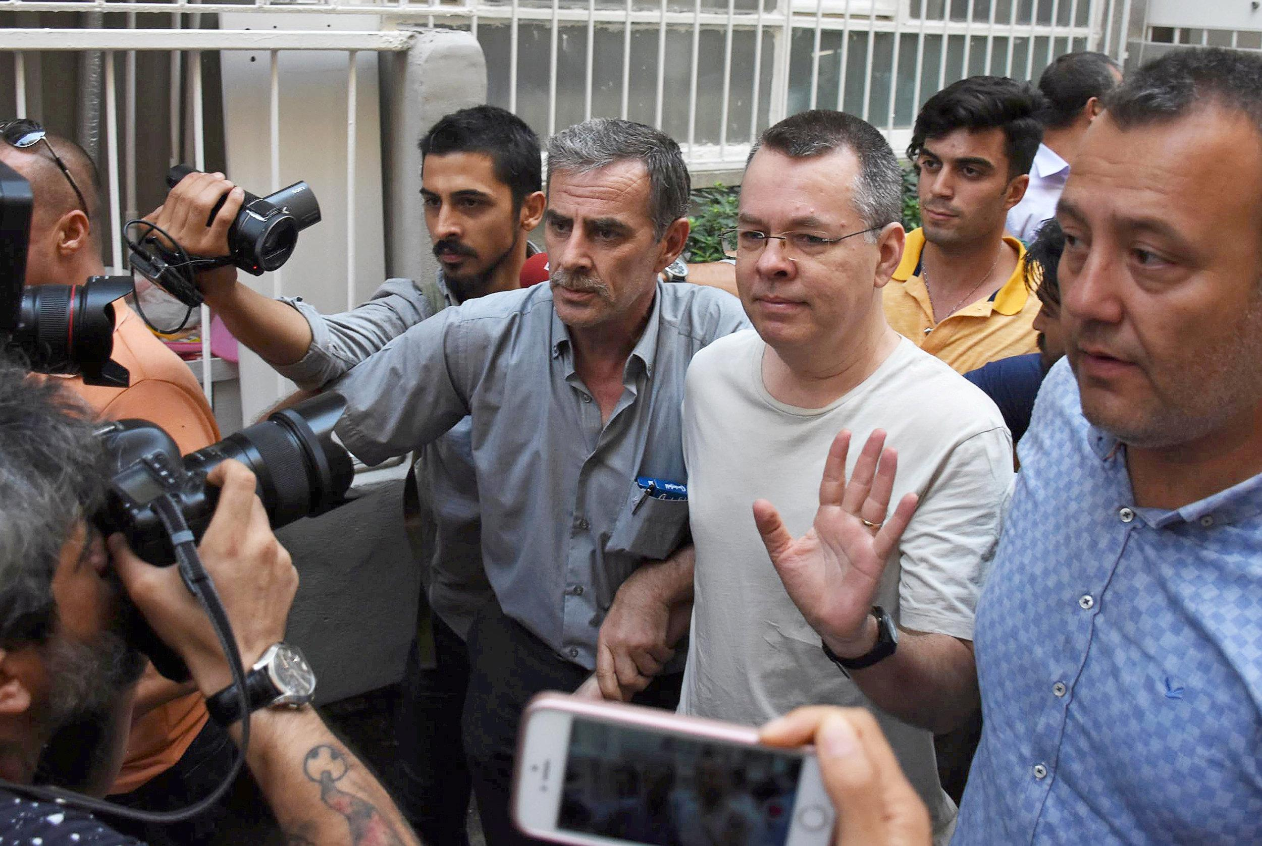 U.S. pastor Andrew Brunson reacts as he arrives at his home after being released from the prison in Izmir, Turkey July 25, 2018. Demiroren News Agency/DHA via