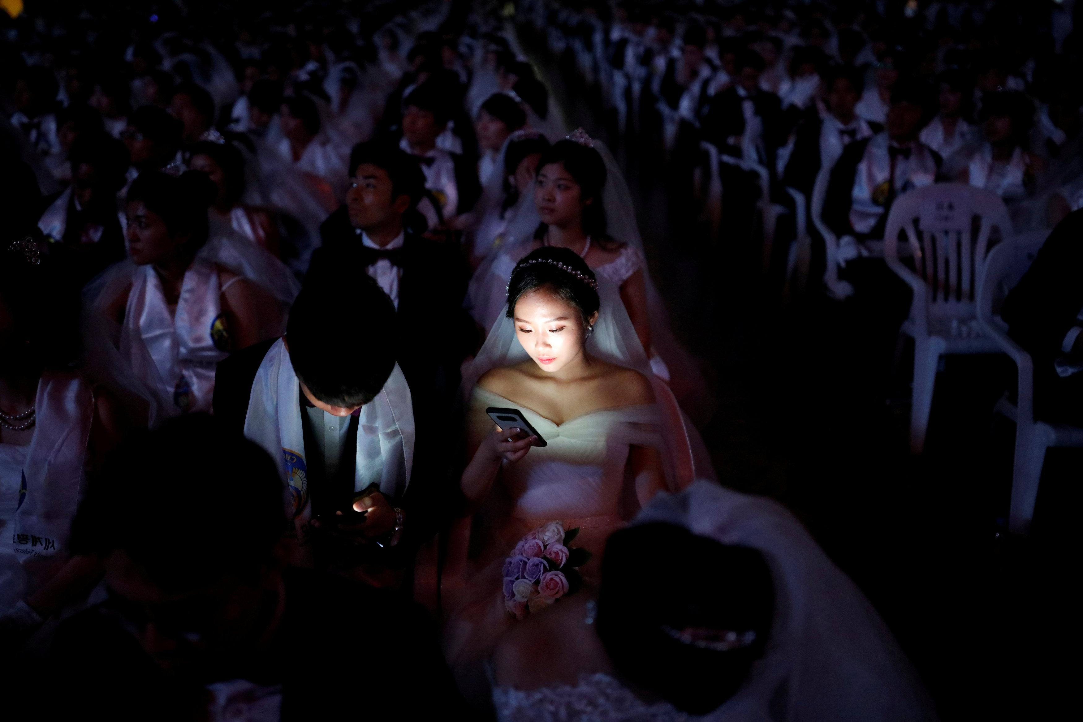 Couples attend a mass wedding ceremony of the Unification Church at Cheongshim Peace World Centre in Gapyeong, South Korea, August 27, 2018.   Kim Hong-Ji