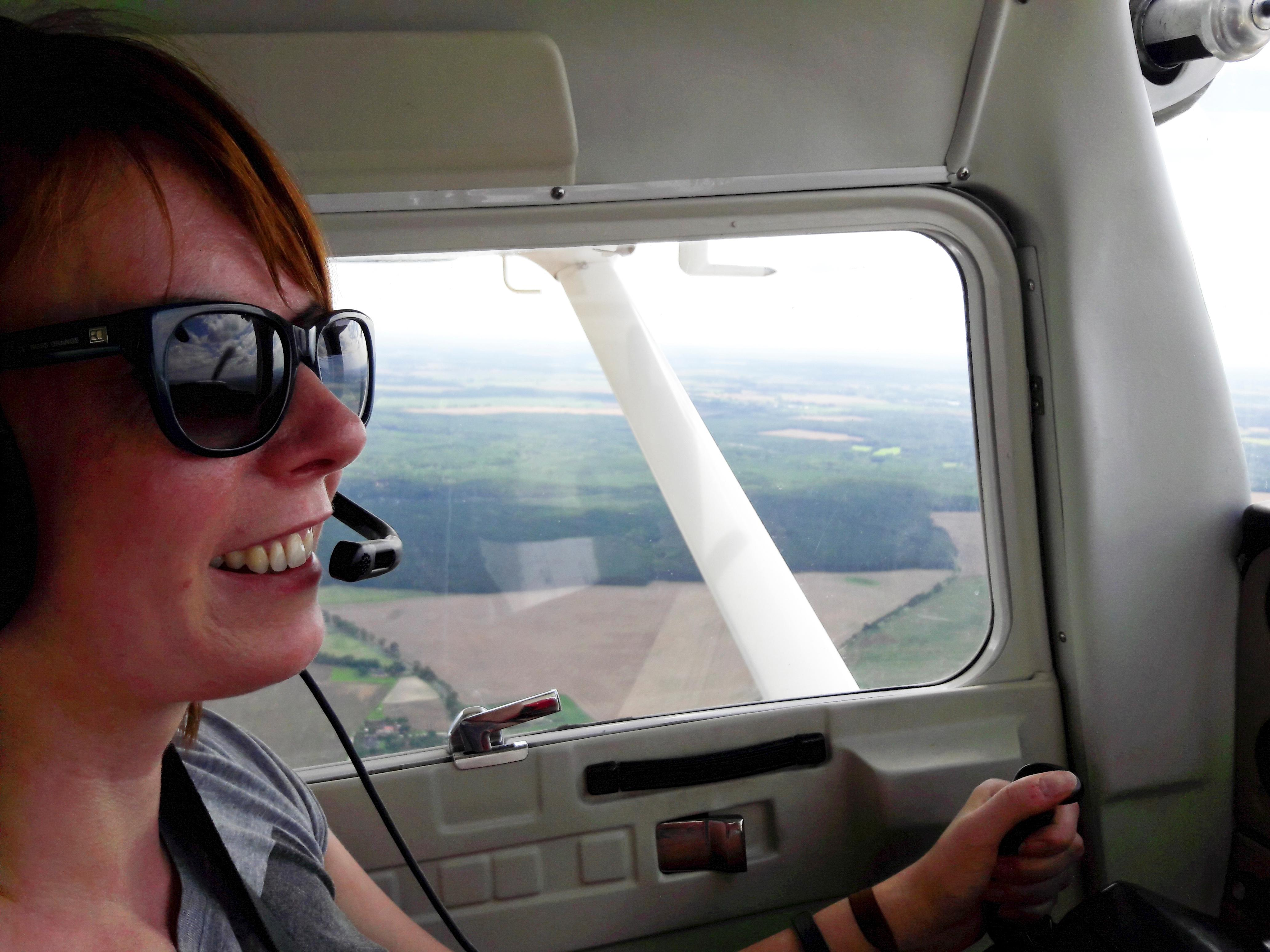 Airline correspondent Victoria Bryan pilots a Cesna 152 plane near Berlin, Germany August 5, 2017. Staff