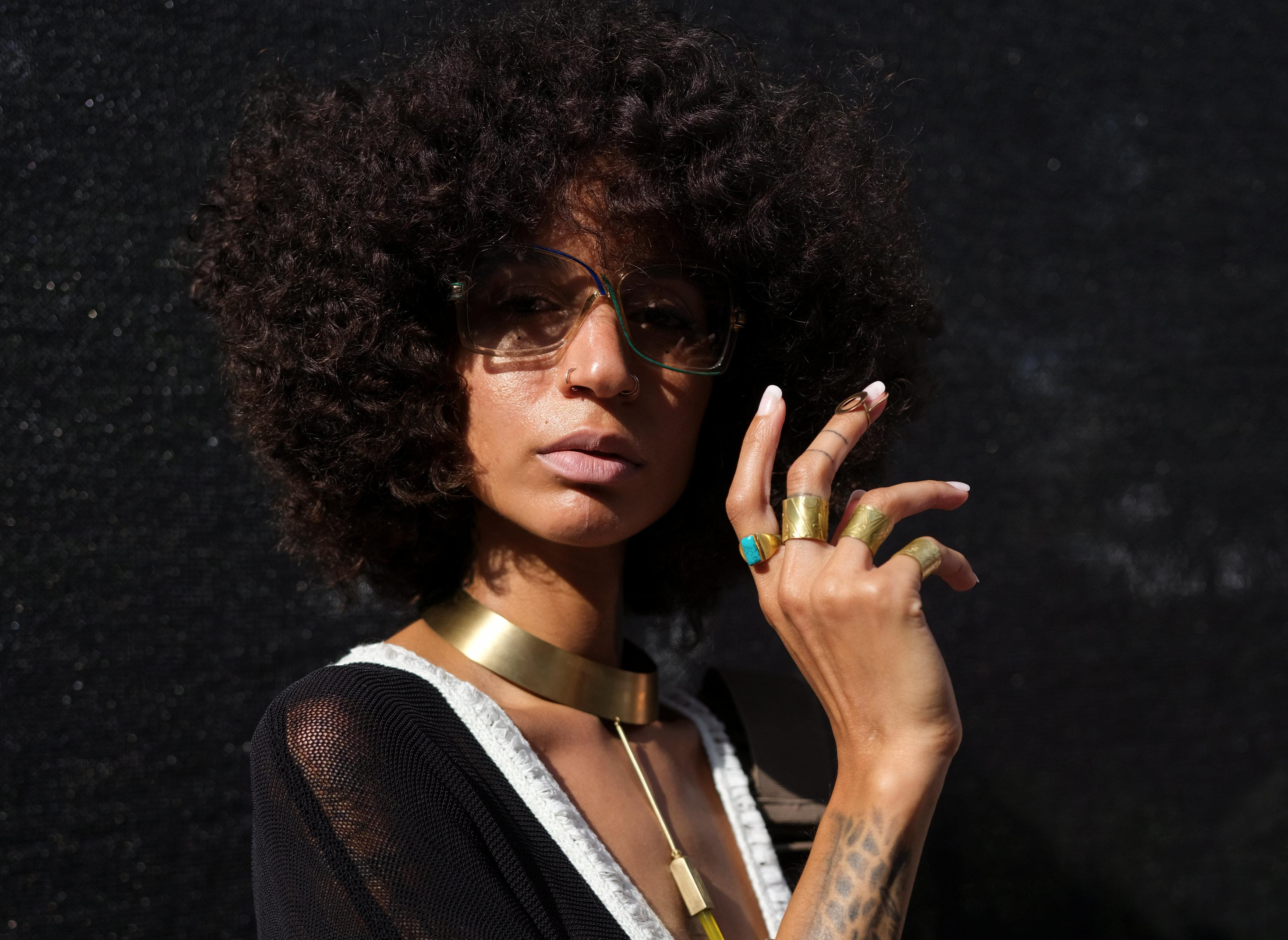 Aziza Nicole, a jewelry designer based in New York, poses for a portrait in the Brooklyn borough of New York, U.S., August 25, 2018.  Caitlin Ochs